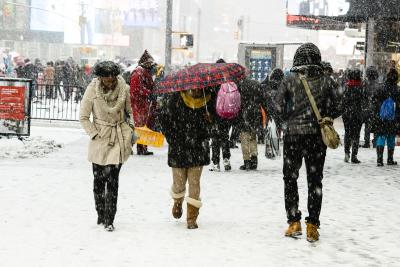 Photo of people walking in the snow
